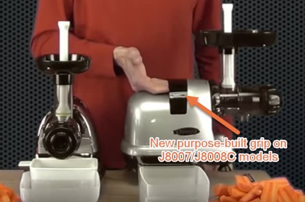 Person gripping the Omega J8008C juicer