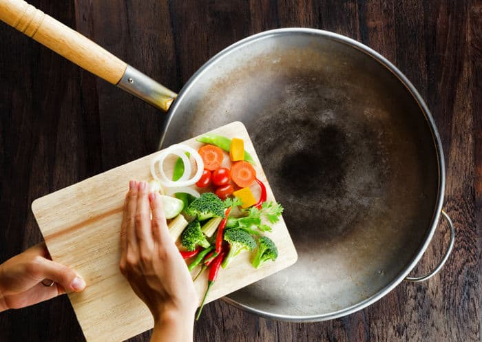 Photo of carbon steel wok with pre-cut veggies