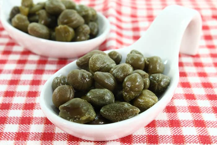 Image of capers on a chekered table