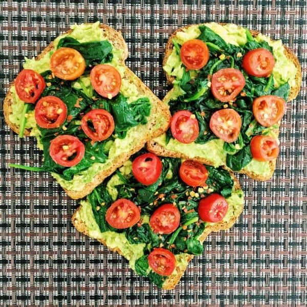 Smashed Avocado Toast with Wilted Spinach and Cherry Tomatoes