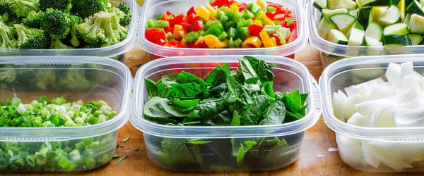 A variety of prepared produce items in different containers