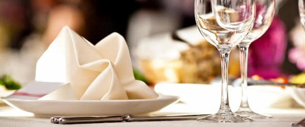 Plate and wine glasses on a restaurant table