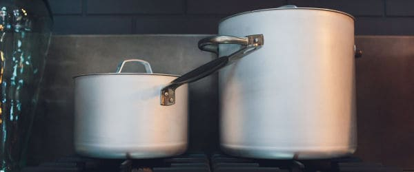 Two big cooking pots on a stove